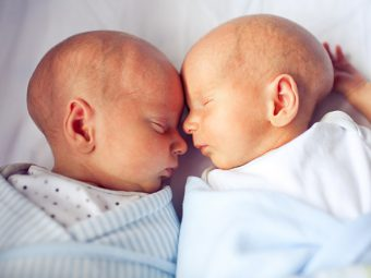 Young Boy Helping Dad Give Skin To Skin Contact To Premature Twins