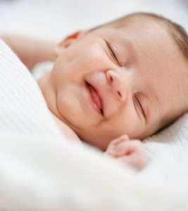 Why-Do-Babies-Smile-In-Their-Sleep1