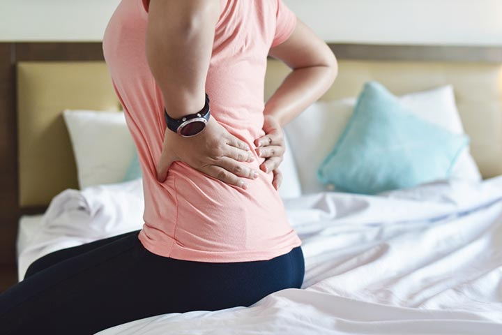 Back Pain During Breastfeeding Causes Tips And Exercises 1