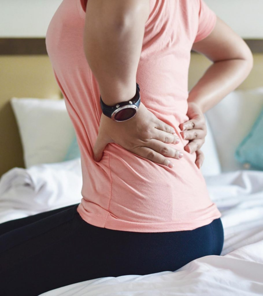 Back Pain During Breastfeeding Causes Tips And Exercises 910x1024